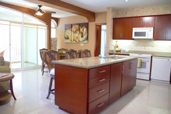 Open living spaces and seating at kitchen island.