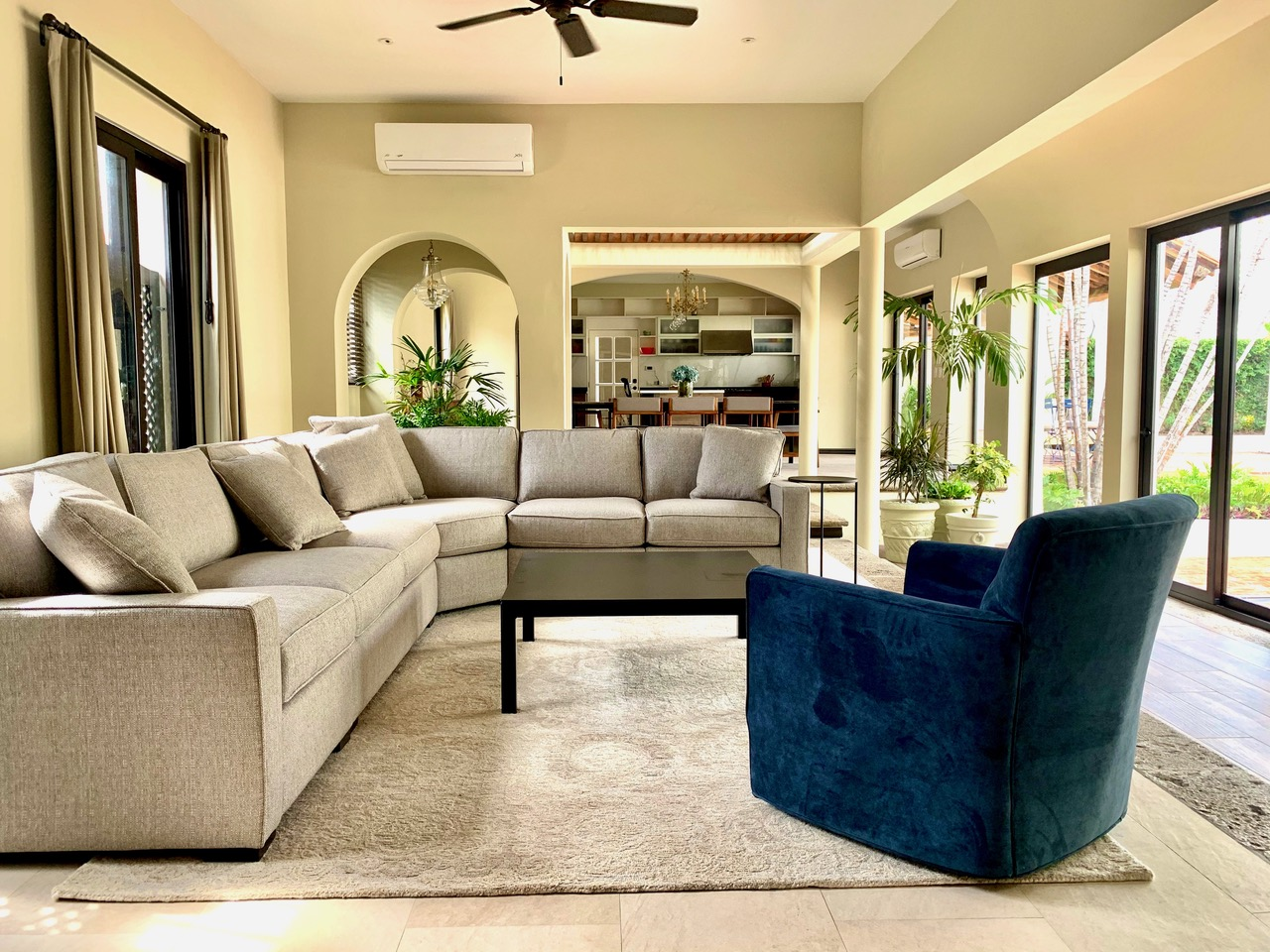 Large sectional sofa, window coverings for privacy.
