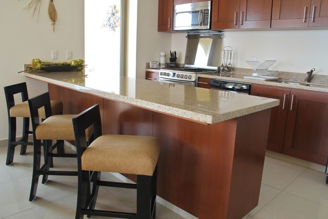 Kitchen with island & seating.
