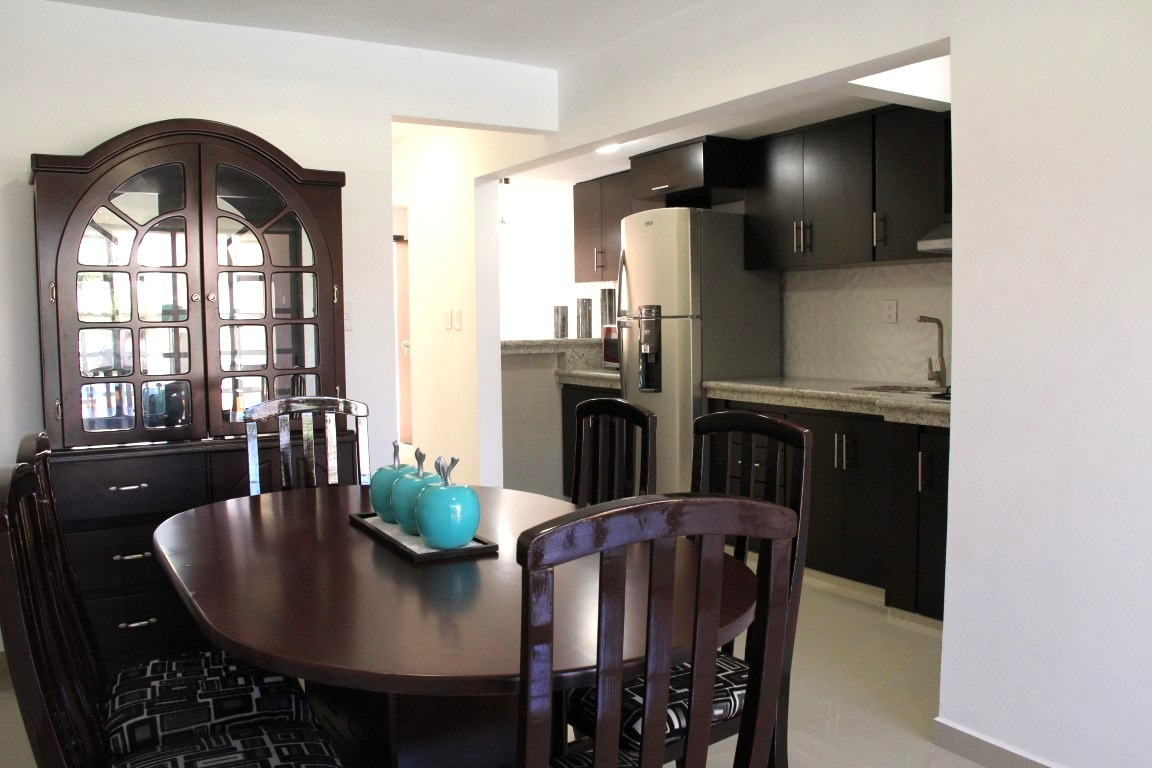 Galley kitchen and dining area.