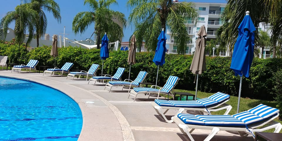 Loungers at Portofino pool.