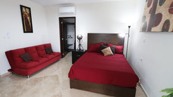 Second bedroom with queen bed and sofa bed.