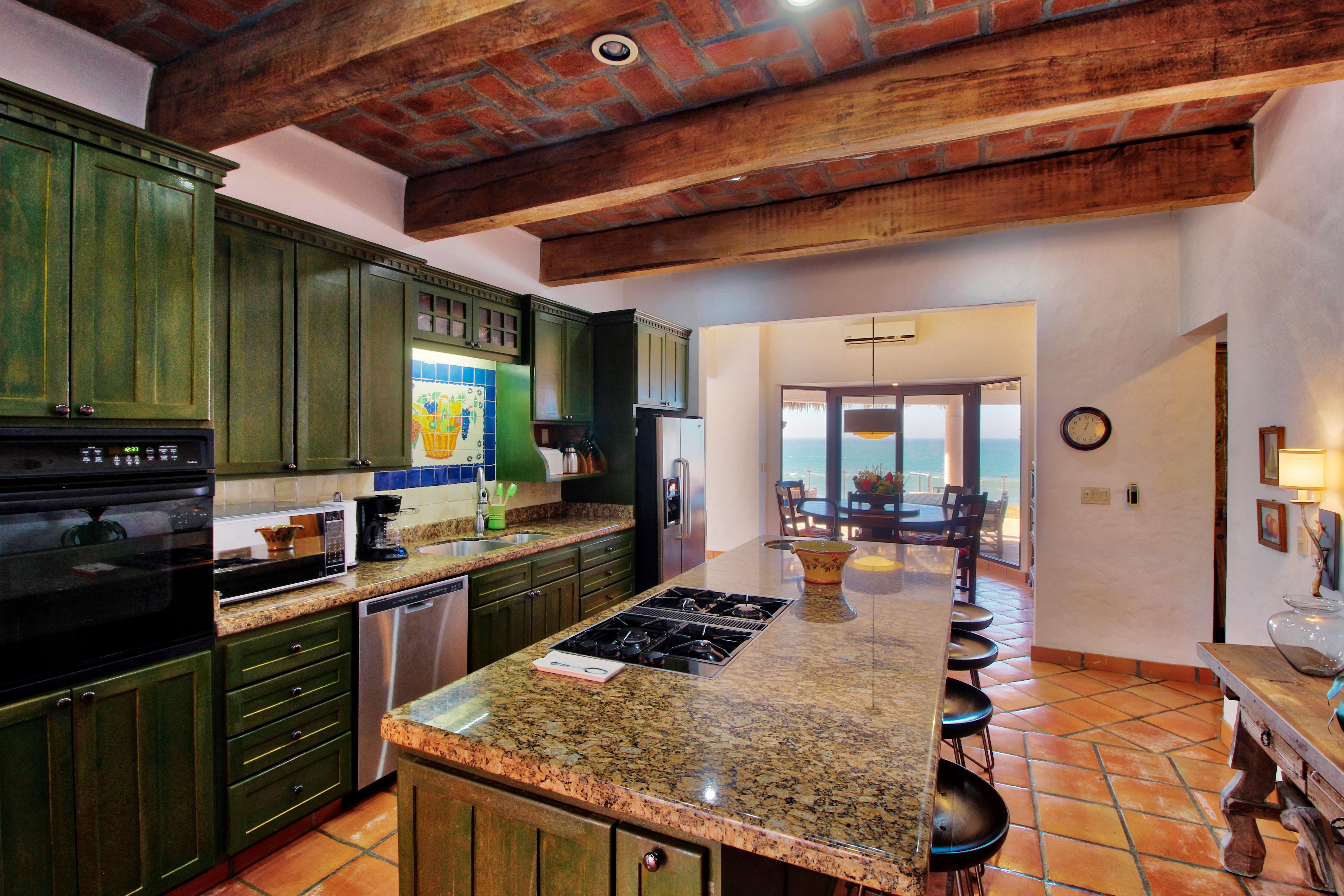 Large, fully stocked kitchen.