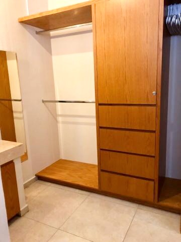 Closet space with locking door.