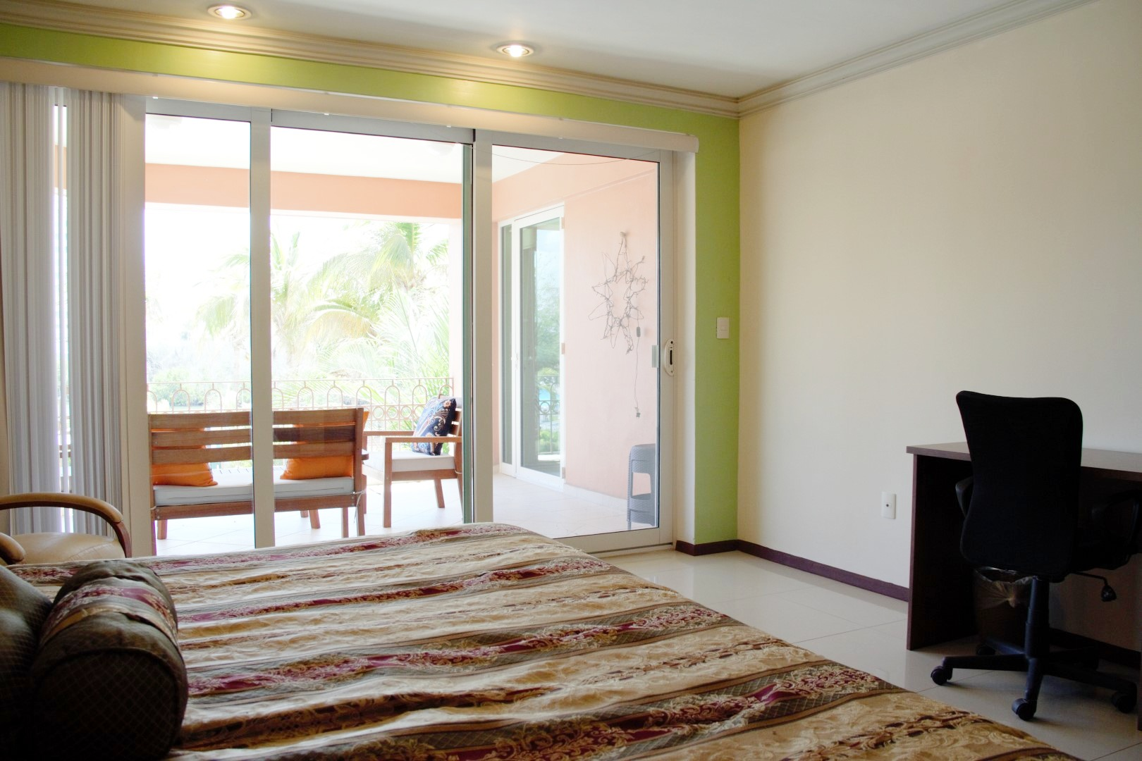 Large bedroom with access to private terrace.