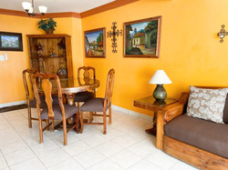 Living room and dining area with table for 4 people.