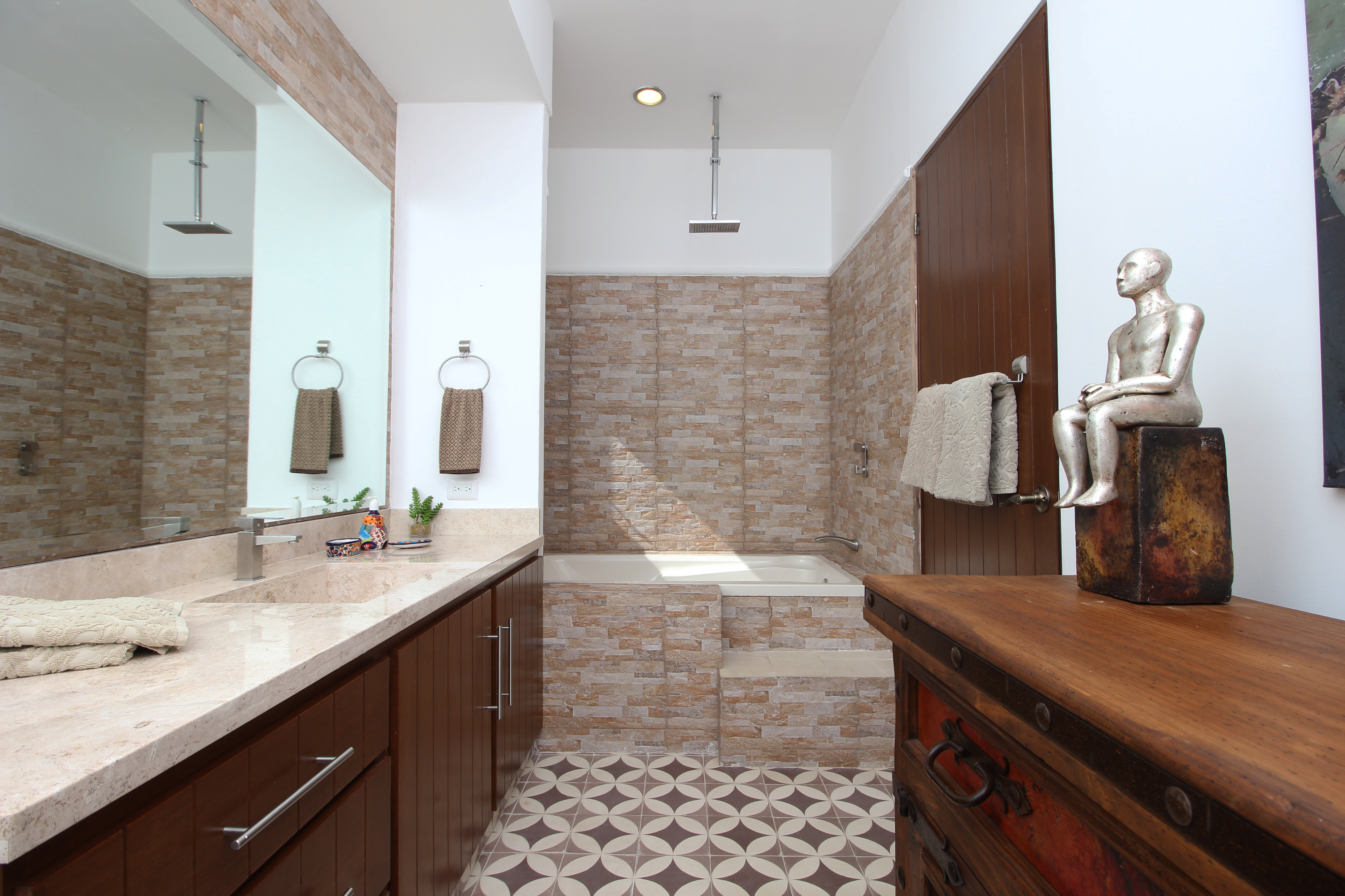 Apartment ensuite with bath tub and shower.