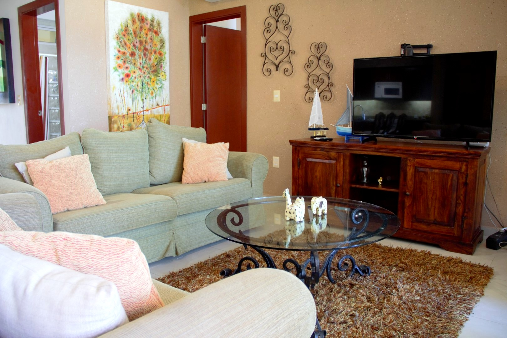 Living room with comfortable sofas and flat-screen TV.