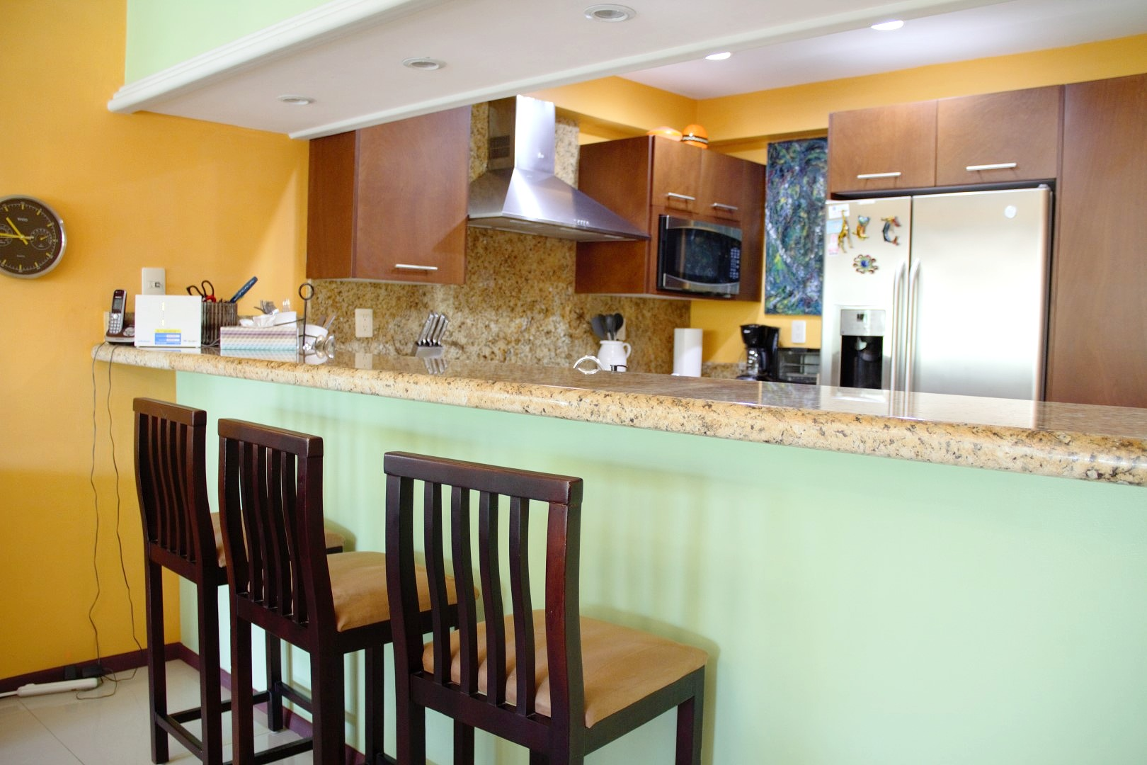 Breakfast bar with seating for 3 people.