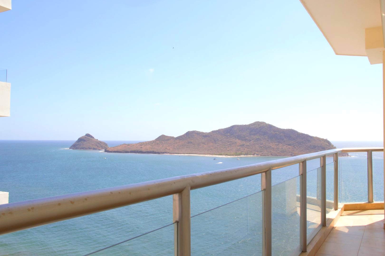 Balcony access and ocean views from second bedroom.