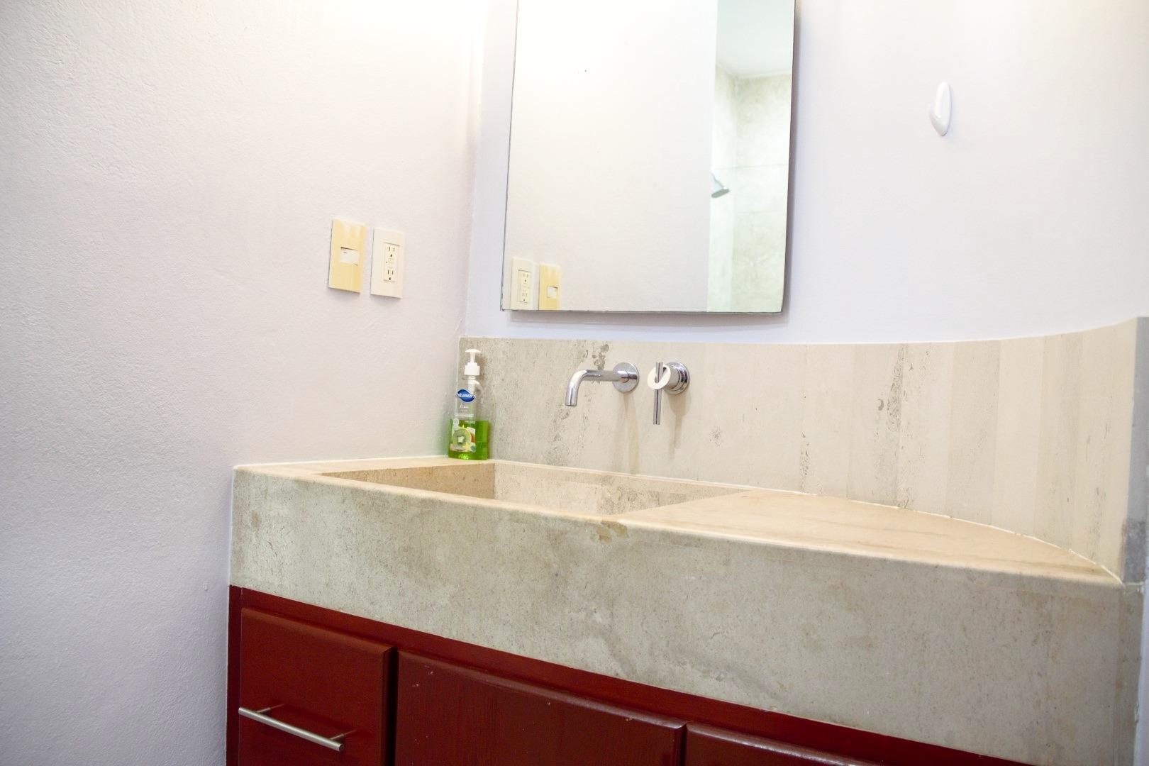 Vanity in shared third bathroom.