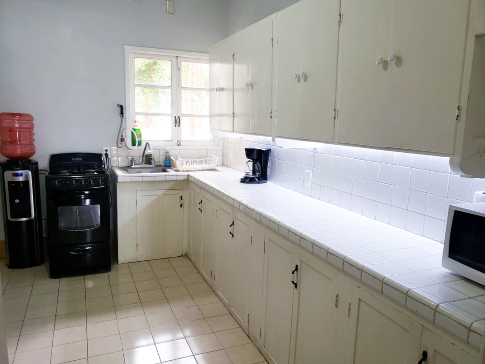 Kitchen with gas stove and oven.