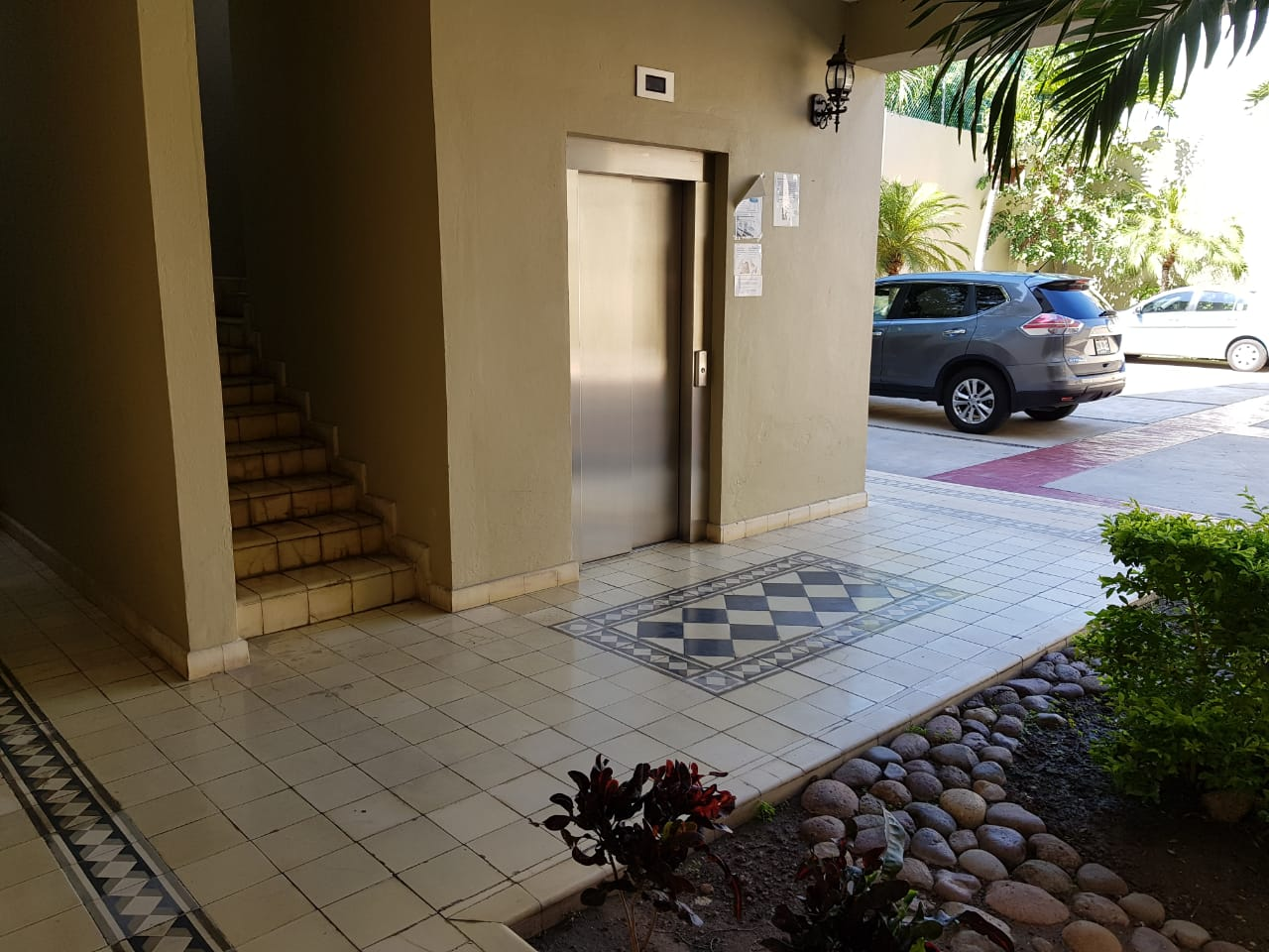 Elevator and stairs up to the condo.