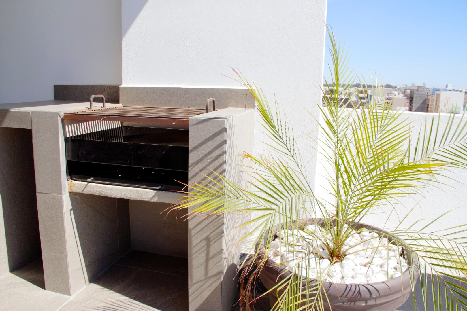 Shared charcoal grill on roof-top.