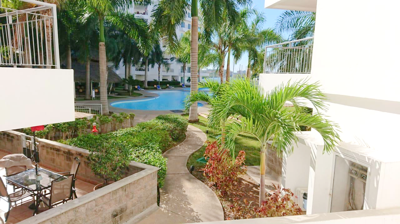 Lush gardens and path to the pool.