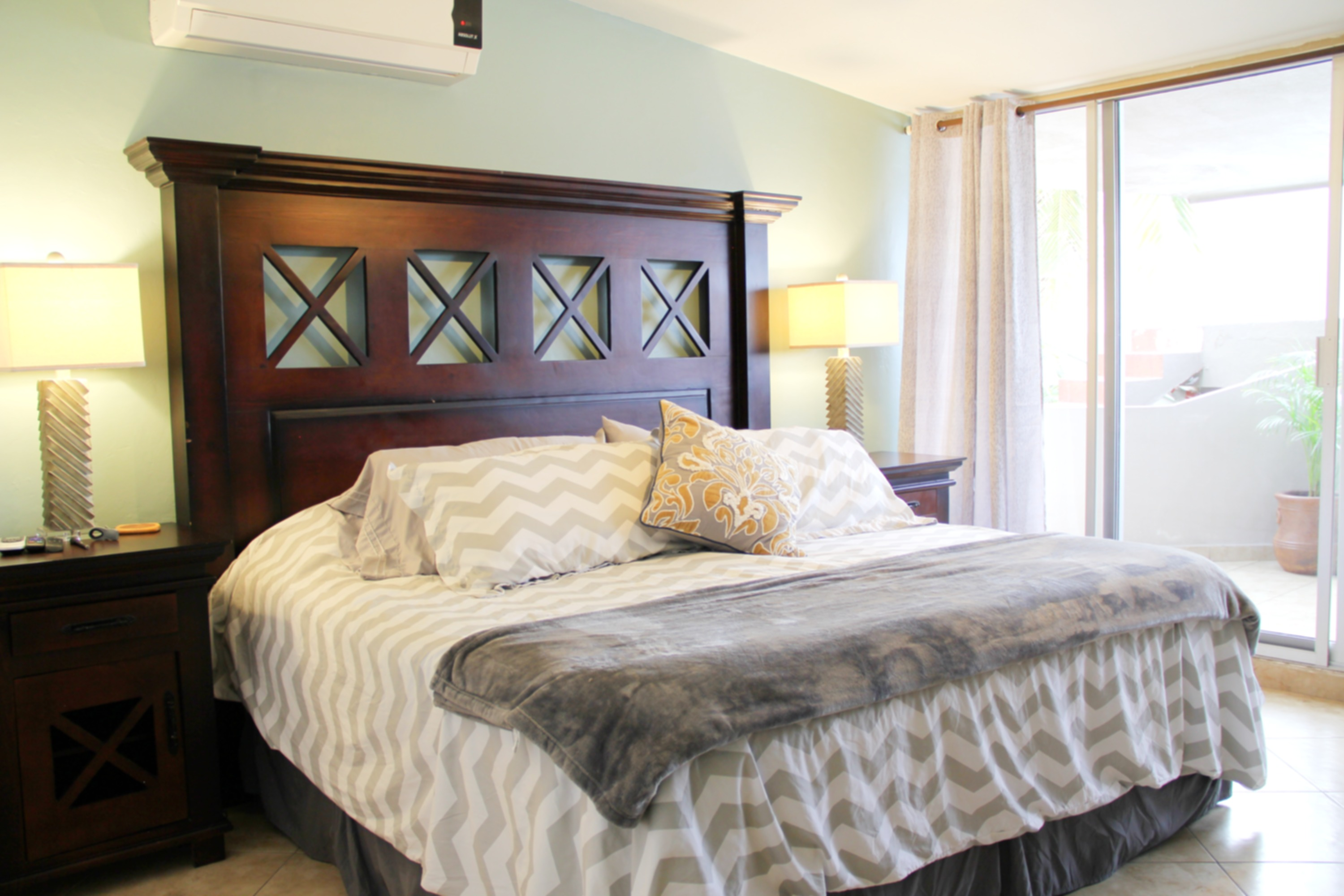 Master bedroom with kingsize bed and patio access.