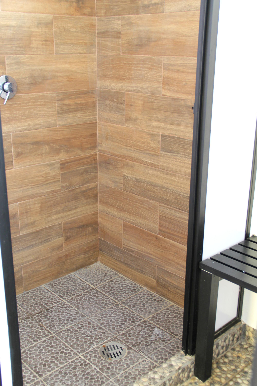 Showers in pool bathrooms.