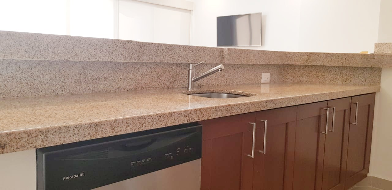 Granite countertops and dishwasher.