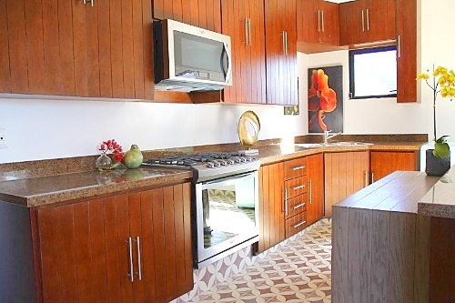 Full kitchen with Smeg mini-fridge in apartment.