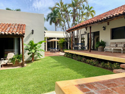 Large private yard with several sitting areas.