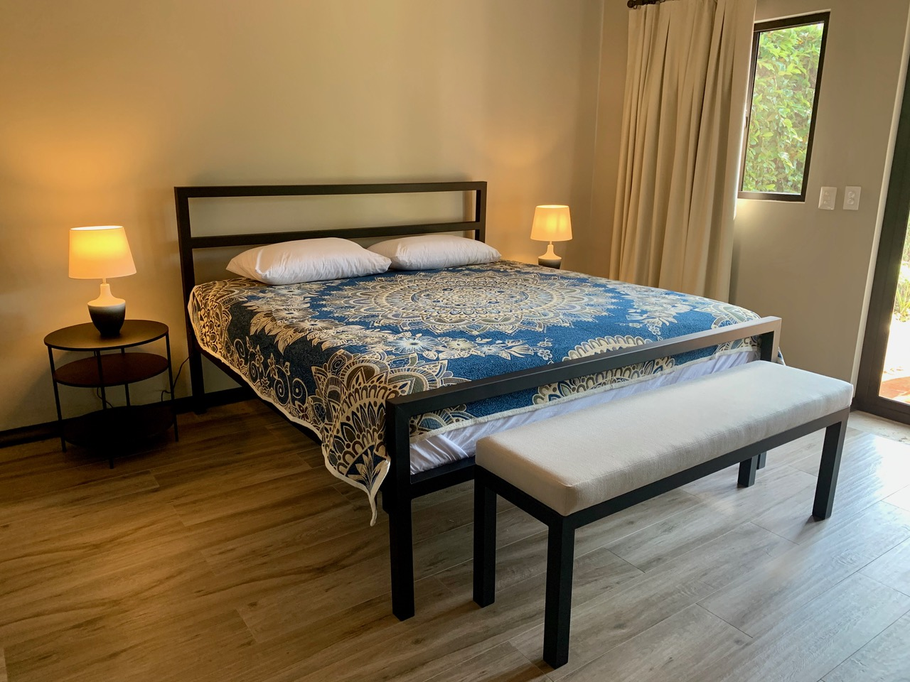 Fourth bedroom in private casita with king-size bed.