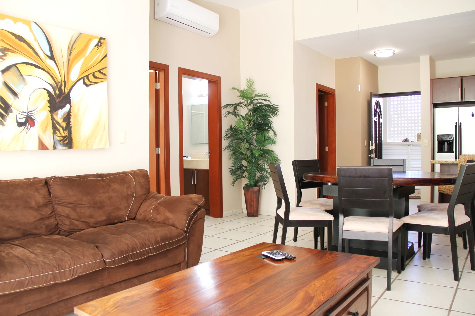 Open living spaces with comfortable furniture.