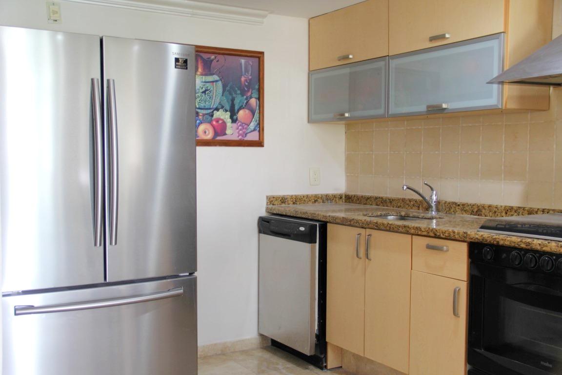 Kitchen with large fridge and dishwasher.