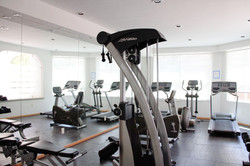 Equipped gym in building.