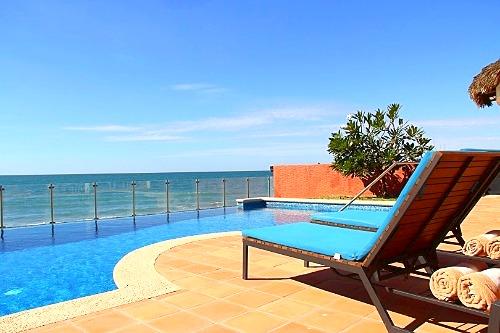 Pool loungers and ocean views.