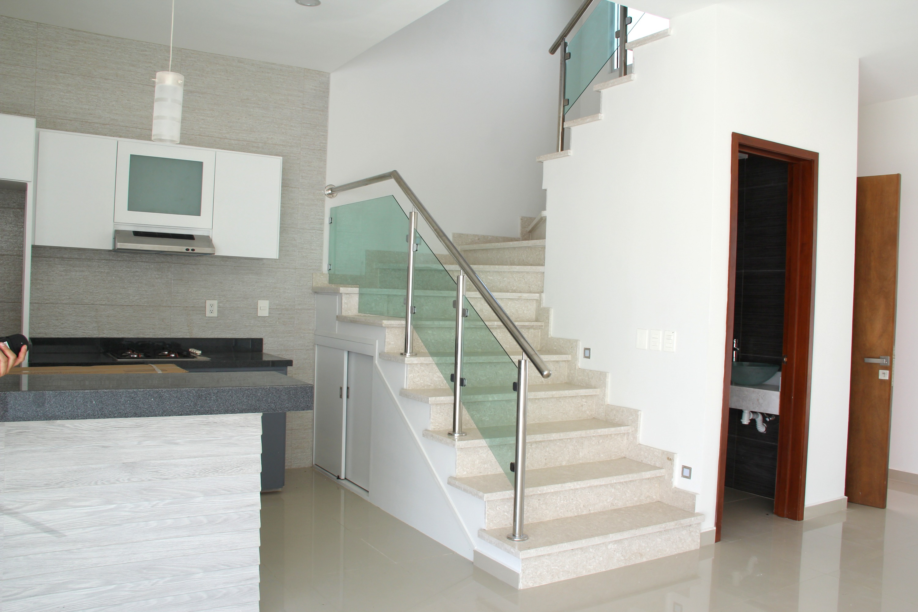 Kitchen and stairs to upper level.