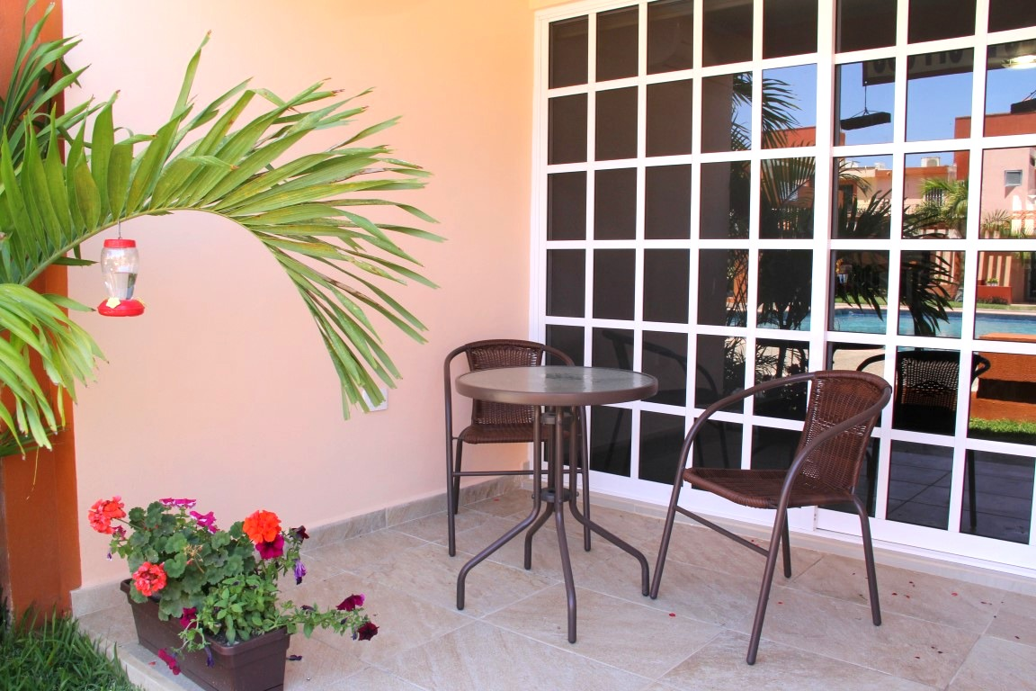 Seating area on covered patio.