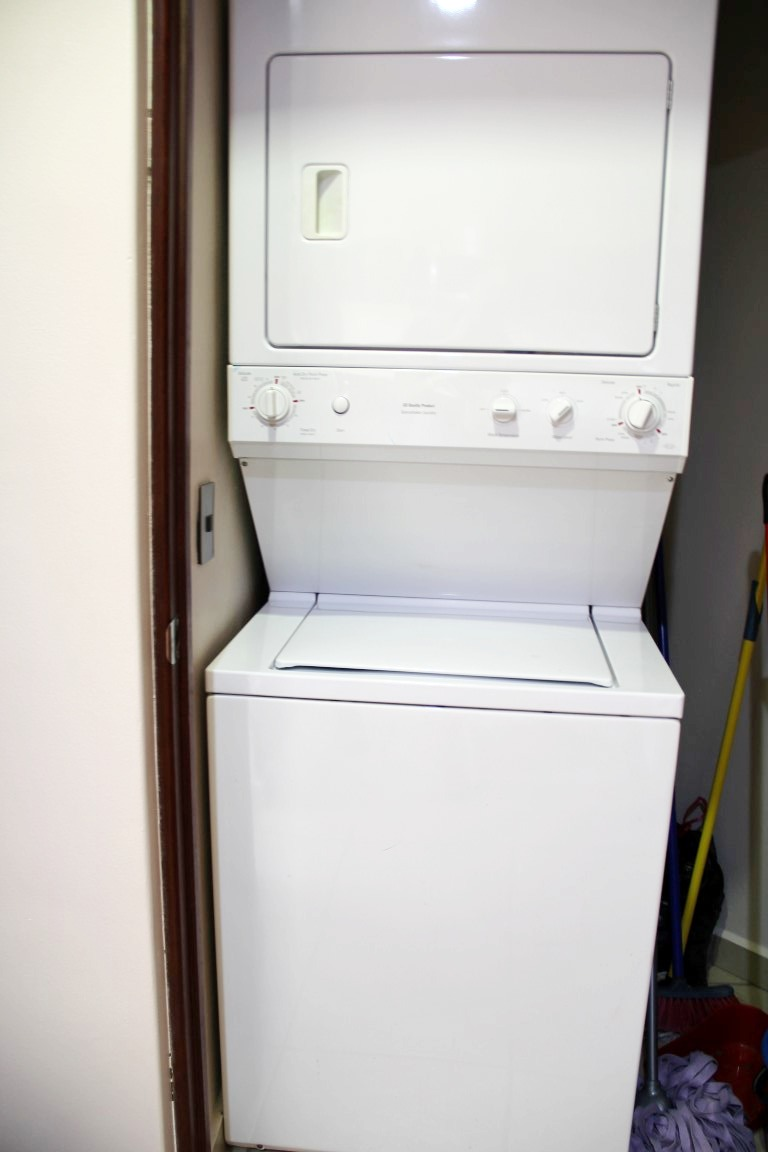 Full-size washer and dryer in condo.