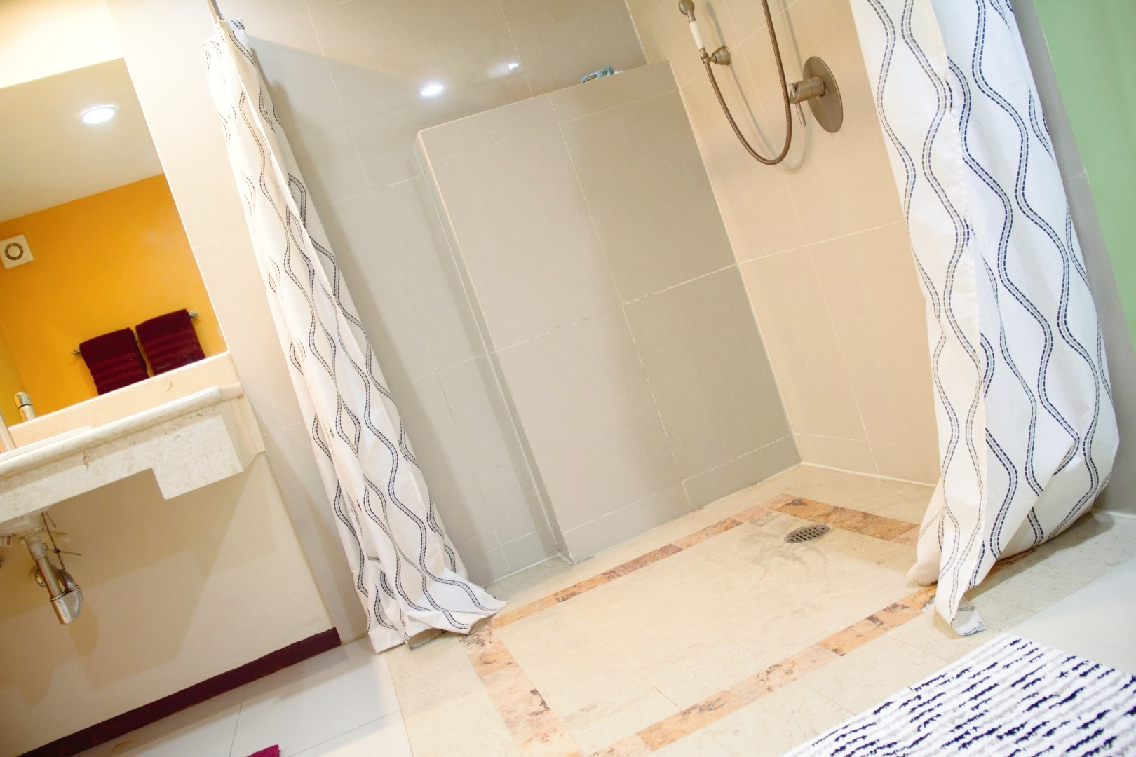 Wheelchair accessible shower in master bathroom.