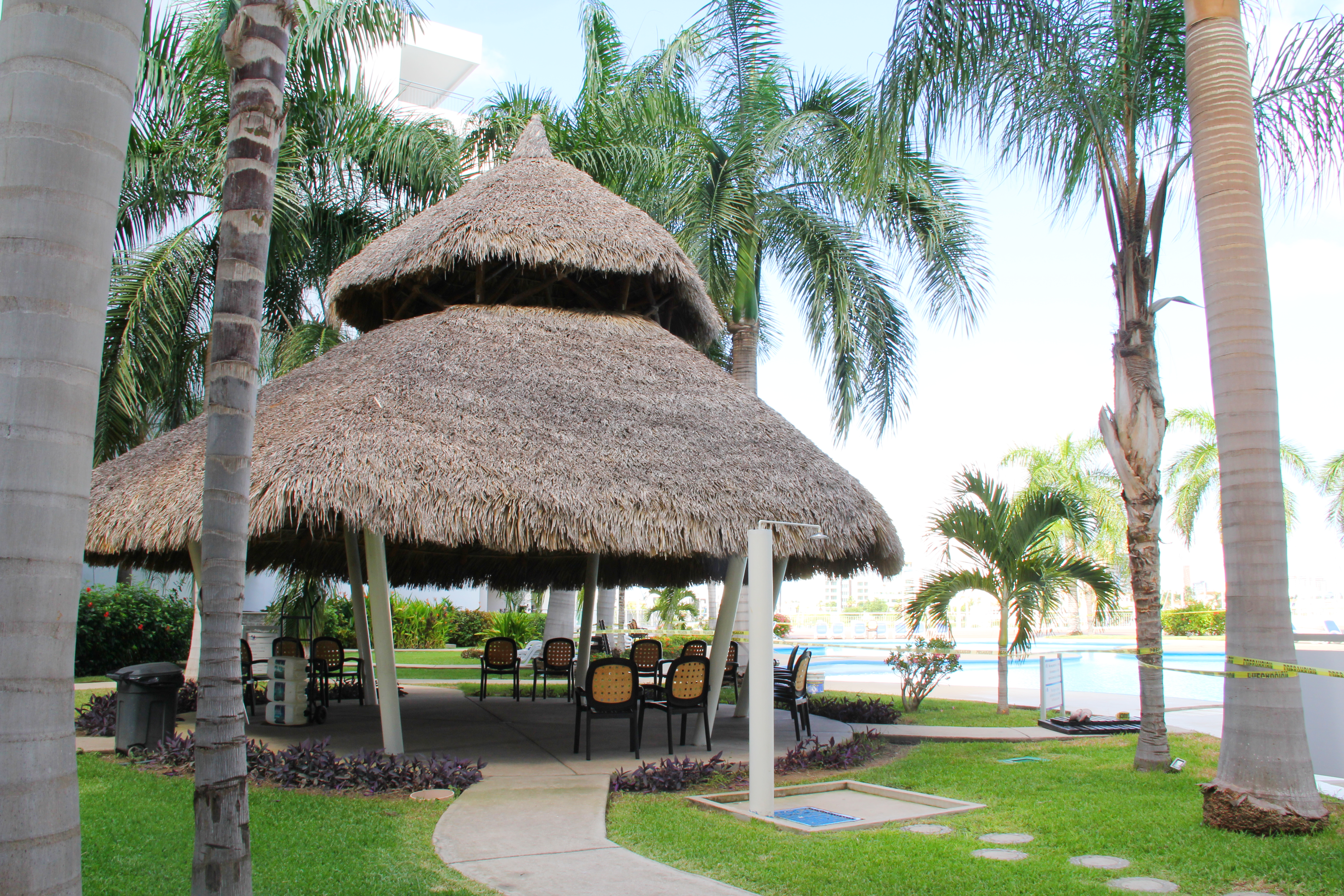 Large shared palapa with seating.