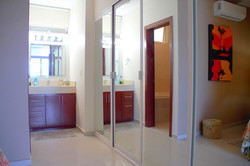 Large mirrored closet doors in second bedroom.