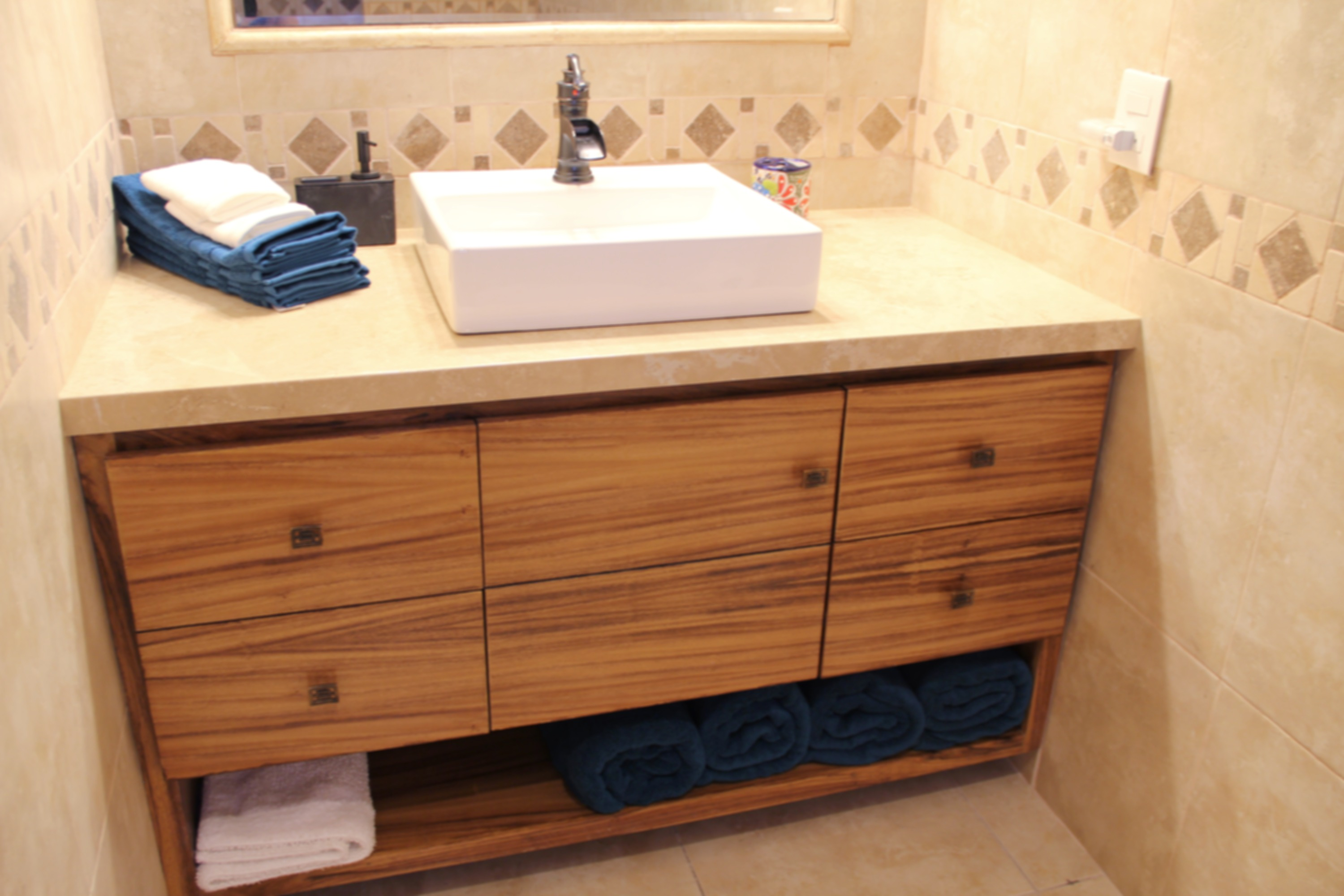 Modern vanity with storage and towels.