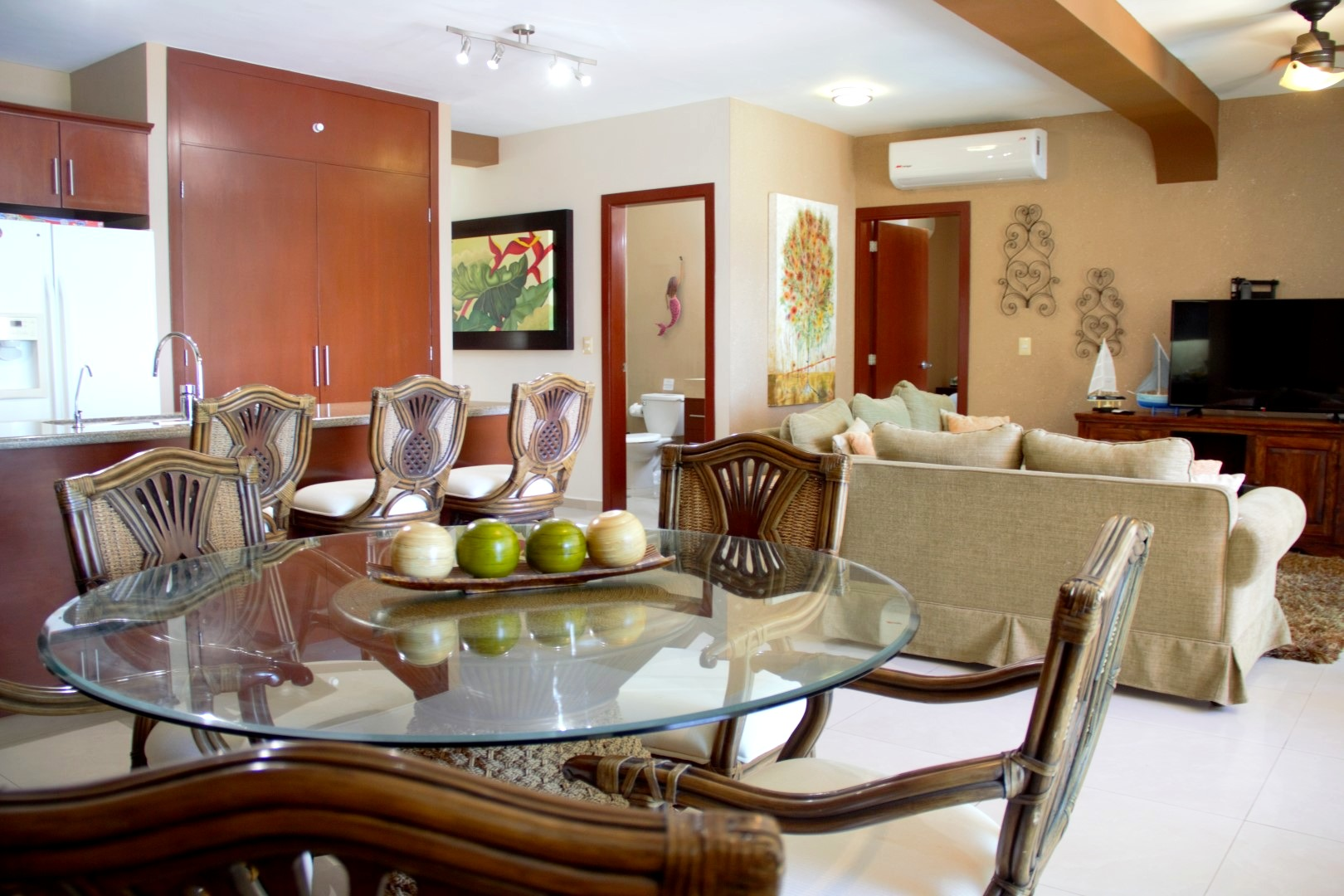 Dining, living and kitchen areas.