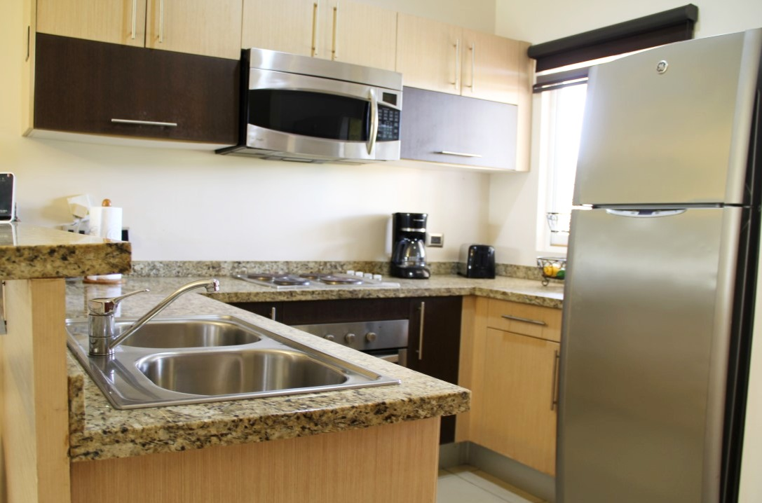 Fully equipped kitchen with electric range.