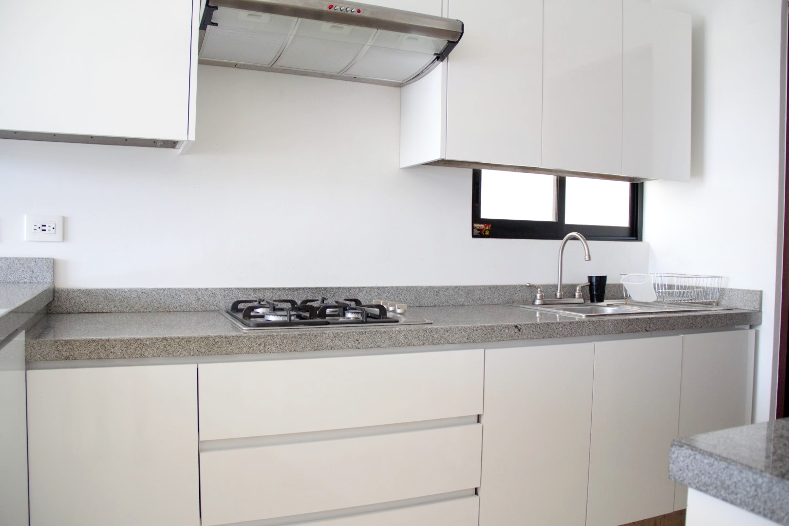 Modern kitchen with gas stove-top.
