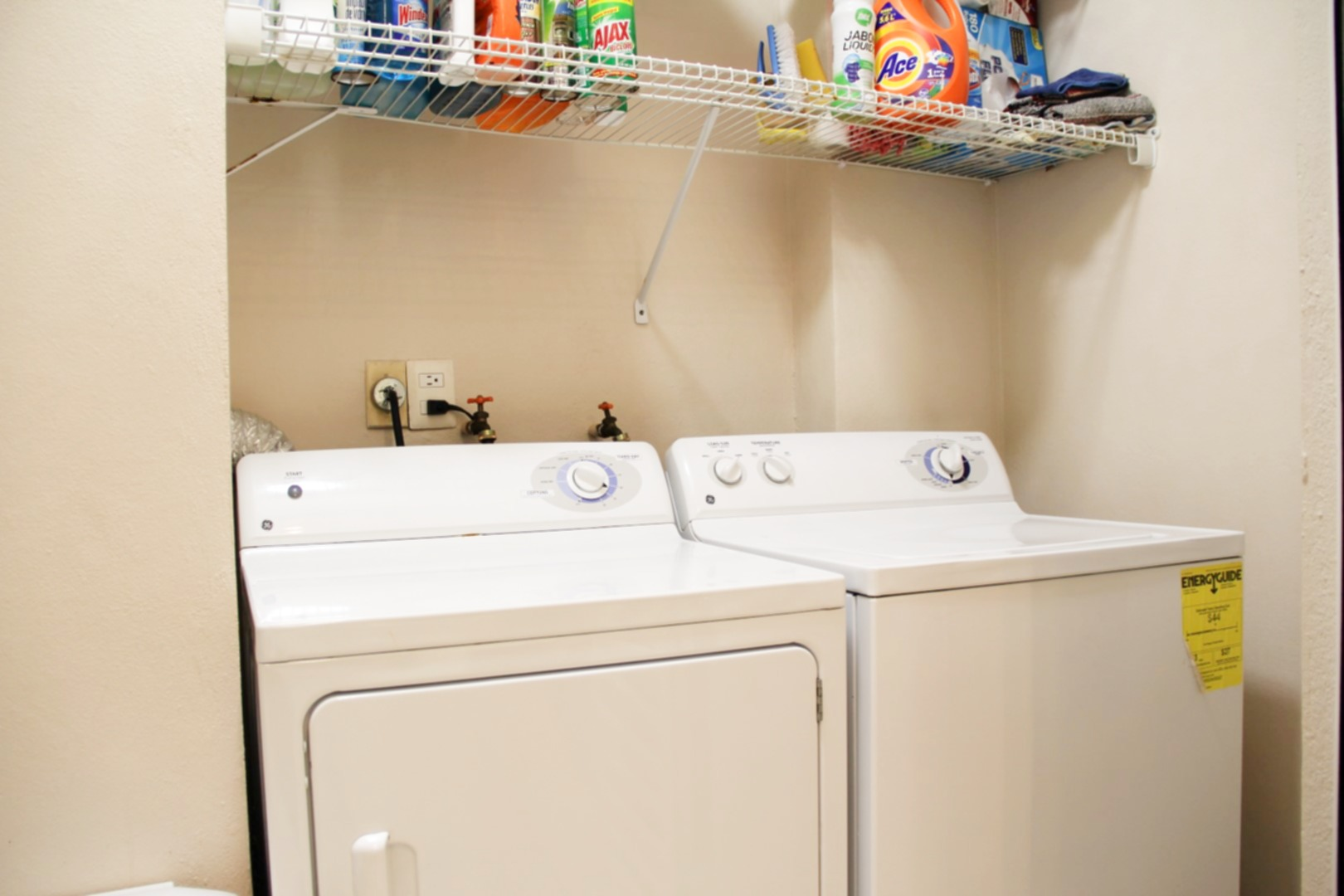 Full-sized washer and dryer off of kitchen.