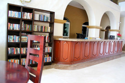 Front desk and book exchange in lobby.