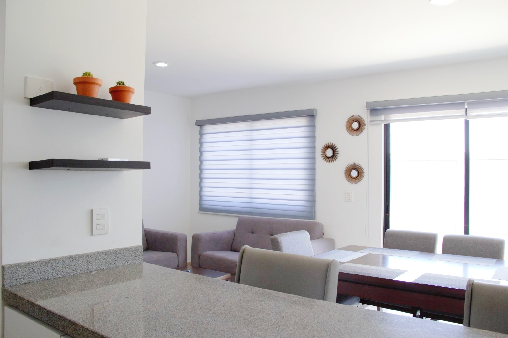 View from kitchen to dining and living areas, as well as patio access.