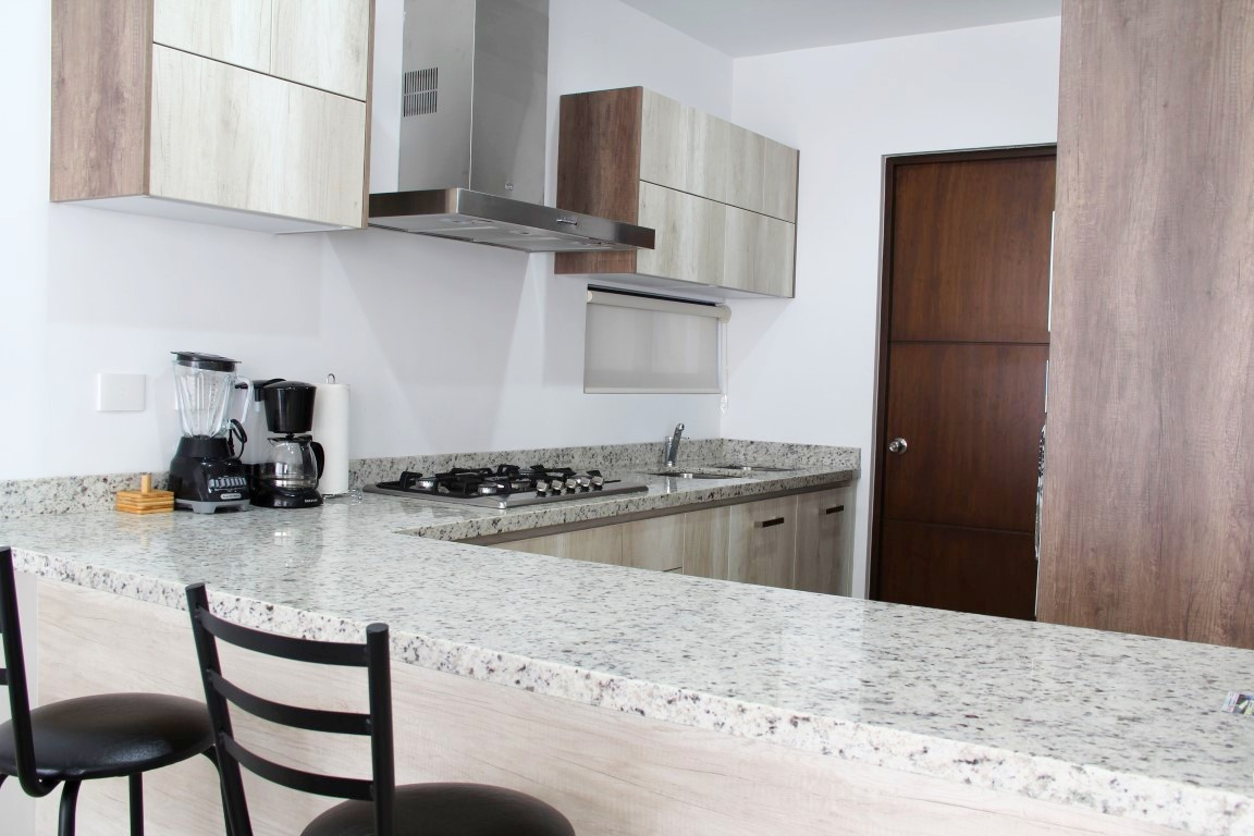 Modern kitchen with breakfast bar.