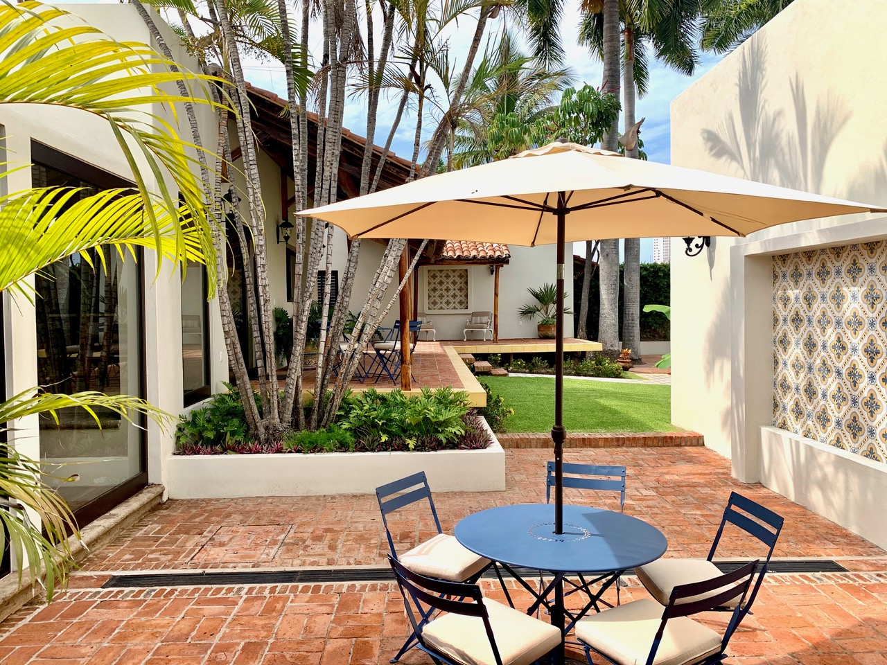 Outdoor dining area with shade umbrella.