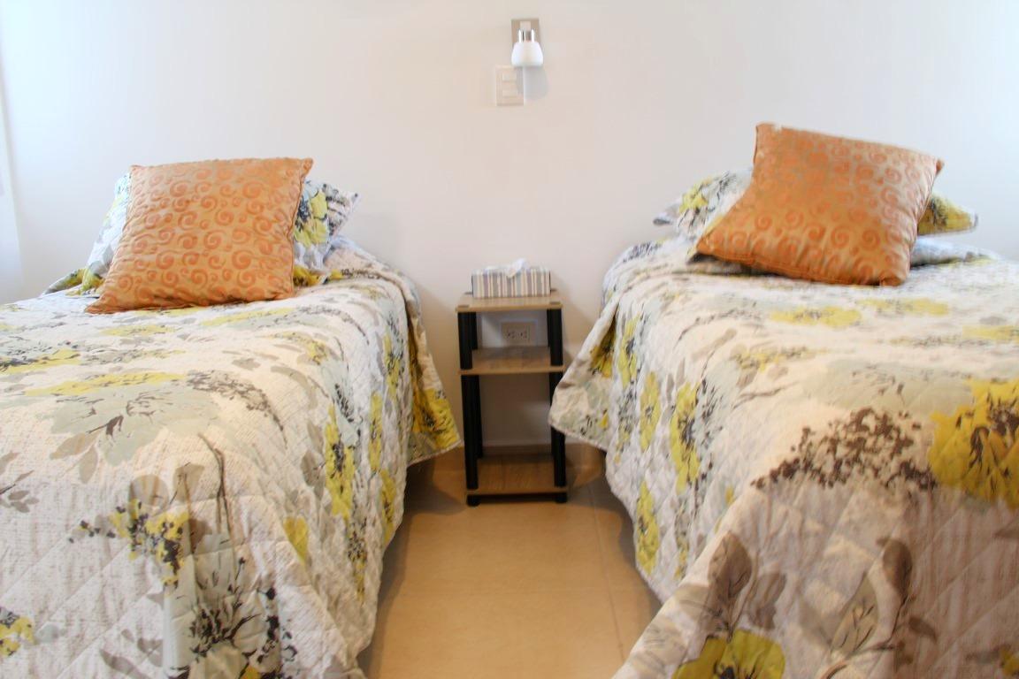 Beds in second bedroom.