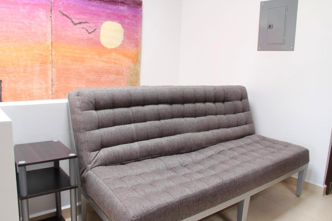 Sofa bed in landing area.
