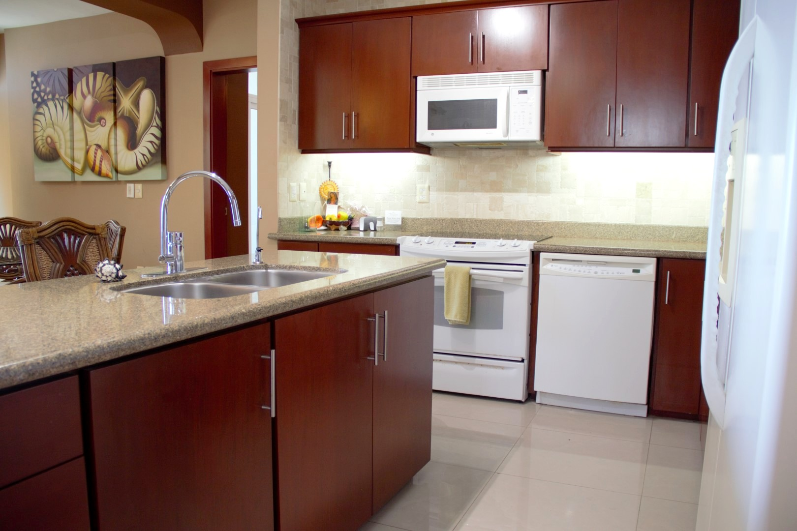 Fully equipped with stove, oven, dishwasher, microwave and fridge.