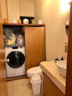 Second half-bath with laundry closet