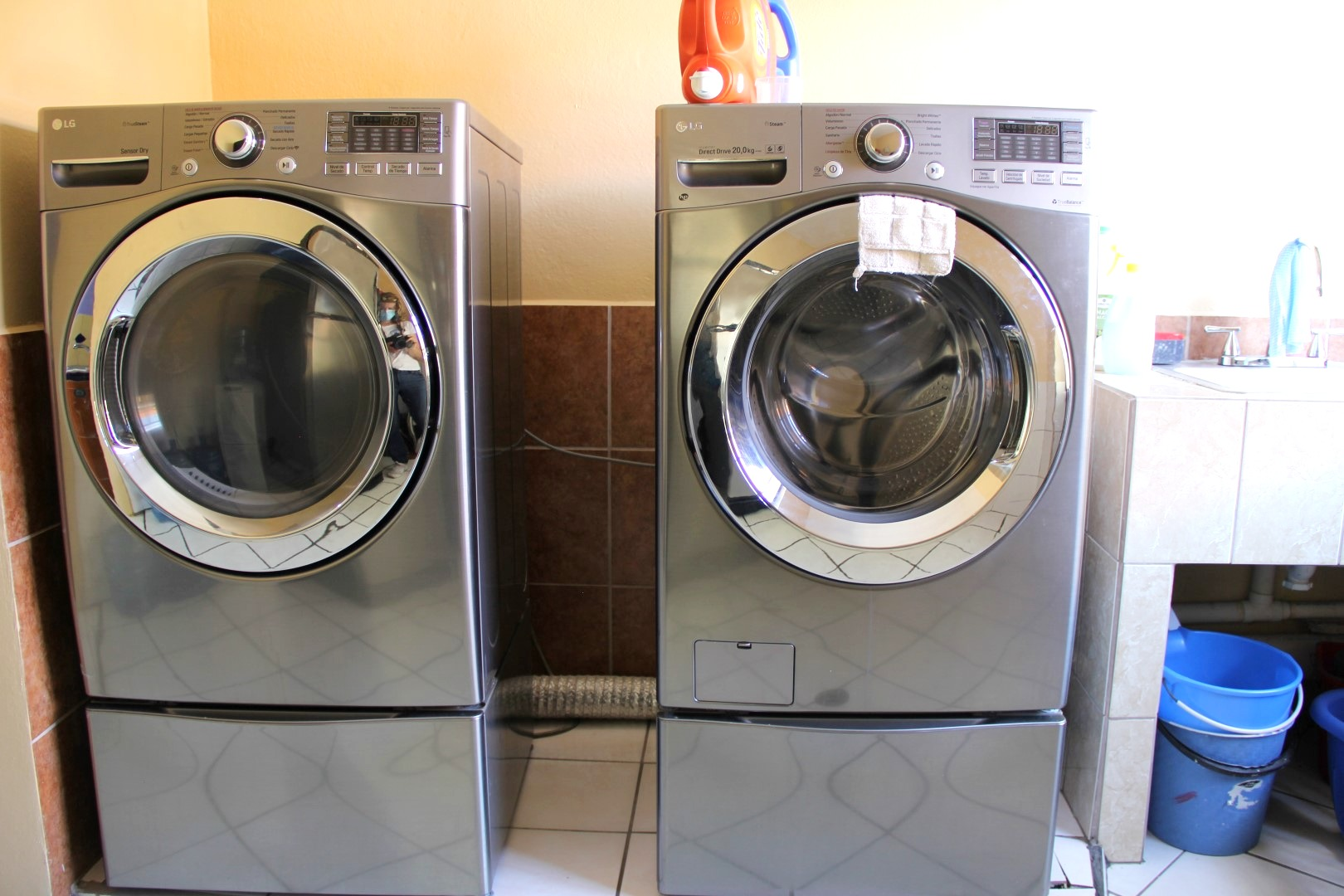 Full size washer and dryer with ironing board.