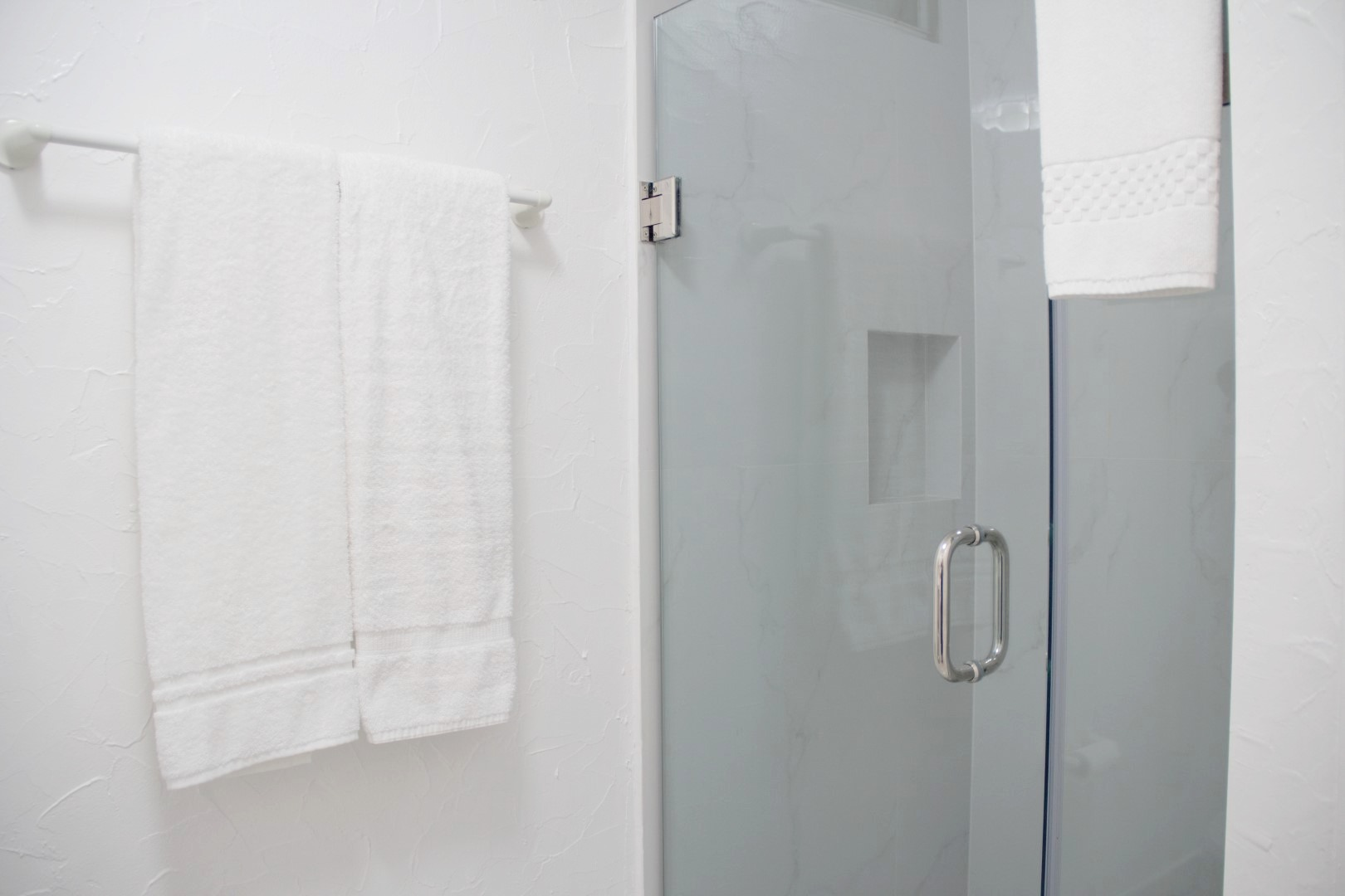 Beautiful new tiled shower with glass door.